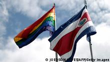 The rainbow flag, which symbolises sexual diversity, is seen after being raised by Costa Rica's President Luis Guillermo Solis, next to Costa Rica's national flag at the presidential house in San Jose May 16, 2014. Solis said he is wanting to work for a country of equality, and asked people to understand and respect diversity, according to local media. REUTERS/Juan Carlos Ulate (COSTA RICA - Tags: POLITICS SOCIETY)