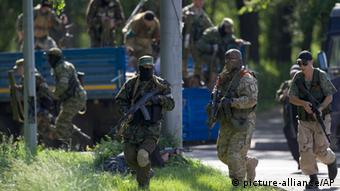 Pro-Russian insurgents arrive near the airport outside Donetsk (Photo: AP Photo/Vadim Ghirda)