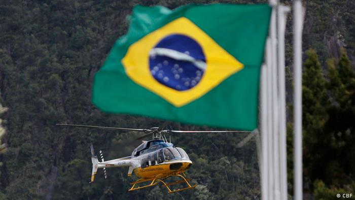 Helicopter with a Brazilian flag in the foreground