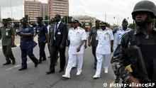 Nigeria's chief of defense staff Air Marshal Alex S. Badeh, second from left, and other army chiefs arrive to address the Nigerians Against Terrorism group during a demonstration calling on the government to rescue the kidnapped girls of the government secondary school in Chibok, in Abuja, Nigeria, Monday, May 26, 2014. Scores of protesters chanting Bring Back Our Girls marched in the Nigerian capital Monday to protest the abductions of more than 300 schoolgirls by Boko Haram, the government's failure to rescue them and the killings of scores of teachers by Islamic extremists in recent years. (AP Photo/Gbenga Olamikan)