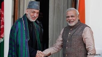 India's Prime Minister Narendra Modi (R) shakes hands with Afghanistan's President Hamid Karzai before the start of their meeting in New Delhi May 27, 2014 (Photo: REUTERS/Adnan)