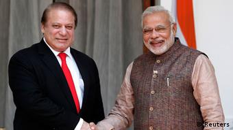 India's Prime Minister Narendra Modi (R) shakes hands with his Pakistani counterpart Nawaz Sharif before the start of their bilateral meeting in New Delhi May 27, 2014 (Photo: REUTERS/Adnan Abidi)