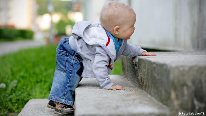 Baby climbing up first steps