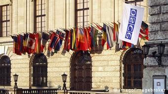 Exterior of OSCE headquarters in Vienna, with flags