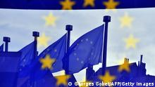 European flags are reflected at the entrance of the Berlaymont building EU Commission in Brussels on May 21,2014. Britain and the Netherlands kick off on May 22, 2014 four-day European elections likely to see major gains for anti-EU parties bent on destroying the European Union from the inside. AFP PHOTO GEORGES GOBET (Photo credit should read GEORGES GOBET/AFP/Getty Images)