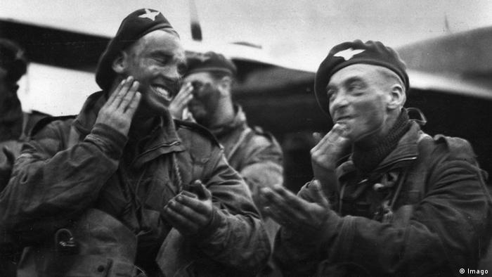 D-Day Paratroopers apply war paint