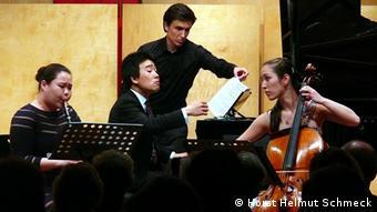 Performers Saerom Kim, Meta Weiss and Jiayan Sun on stage