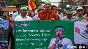 People protest against the trial in Phnom Penh in May 2014