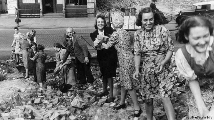 Women clearing rubble after WWII