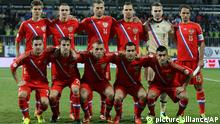 Russia's national team players bottom row from the left: Victor Faizulin, Dmitry Kombarov, Denis Glushakov, Alexander Kerzhakov, Alexander Samedov, top row from the left: Alexander Kokorin, Alexey Kozlov, Vasili Berezutsky, Sergey Ignashevich, Igor Akinfeev, and Roman Shirokov pose for a photo prior their World Cup Group F qualifying soccer match between Russia and Azerbaijan in Baku, Azerbaijan, Tuesday, Oct. 15, 2013.Russia qualified for the World Cup for the first time in 12 years by drawing 1-1 with 10-man Azerbaijan on Tuesday. (AP Photo/Alexander Mysyakin)