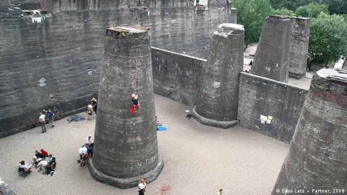Rock climbers utilize the remnants of old concrete pillars for excercise