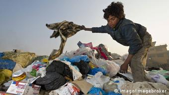 Child on waste dump, India