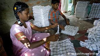 children folding towels