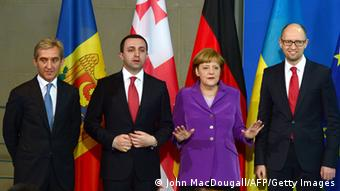 German Chancellor Angela Merkel stands alongside heads of state from Moldova, Georgia and Ukraine