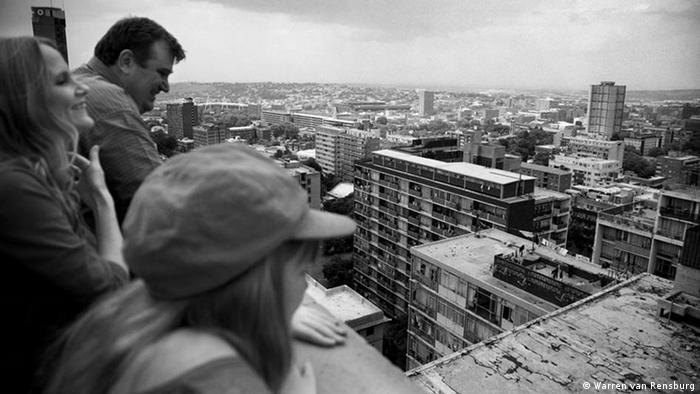 The Brankenfamily atop a building in a black-and-white photograph from Johannesburg, South Africa