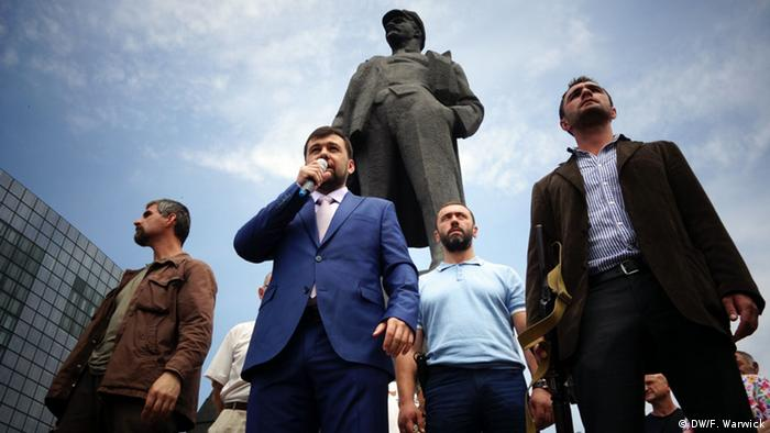 Denis Pushilin and other separatist leaders address a miner's rally.