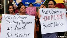 Members of civil society and the Human Rights Commission of Pakistan hold placards during a protest in Islamabad May 29, 2014 against the killing of Farzana Iqbal, 25, by family members on Tuesday in Lahore. Pakistani Prime Minister Nawaz Sharif has demanded to know why police apparently stood by while Farzana Iqbal, a pregnant woman, was stoned and beaten to death by her family in front of one of the country's top courts, his spokesman said on Thursday. She was attacked on Tuesday, police said, because she had married the man she loved. Her husband said that police did nothing during the 15 minutes the violence lasted outside Lahore High Court. REUTERS/Faisal Mahmood (PAKISTAN - Tags: CIVIL UNREST POLITICS CRIME LAW)