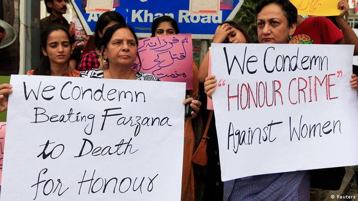 Members of civil society and the Human Rights Commission of Pakistan hold placards during a protest in Islamabad May 29, 2014 against the killing of Farzana Iqbal, 25, by family members on Tuesday in Lahore (Photo: REUTERS/Faisal Mahmood)