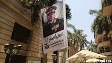 A poster of Abdel Fattah al-Sisi hangs outside the stock exchange in Cairo, May 29, 2014. Al-Sisi, the general who toppled Egypt's first freely elected leader, took more than 90 percent of the vote in the presidential election, provisional results showed on Thursday, joining a long line of leaders drawn from the military. The stock market which fell 2.3 percent on Wednesday as some players said the turnout was a disappointment, was down two percent by midday on Thursday. On the black market, the Egyptian pound weakened slightly. Poster reads, Long live Egypt. Abdel Fattah al-Sisi for the president of the republic. REUTERS/Amr Abdallah Dalsh (EGYPT - Tags: POLITICS ELECTIONS CIVIL UNREST)