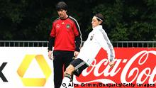 FRANKFURT AM MAIN, GERMANY - JUNE 01: Head coach Joachim Loew of Germany watches Mesut Oezil exercise during a training session ahead of their UEFA EURO 2012 qualifier against Austria on June 1, 2011 in Frankfurt am Main, Germany. (Photo by Alex Grimm/Bongarts/Getty Images)