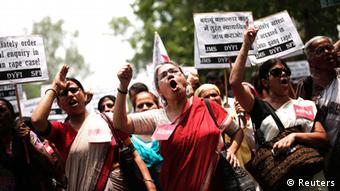 Demonstrators from All India Democratic Women's Association (AIDWA) hold placards and shout slogans during a protest against the recent killings of two teenage girls, in New Delhi May 31, 2014. India's new Home Minister Rajnath Singh weighed in on Friday in a grisly case in which two teenage girls were raped and hanged from a tree this week in the northern Indian state of Uttar Pradesh, as public anger and political controversy over the attack gain momentum. REUTERS/Adnan Abidi (INDIA - Tags: CIVIL UNREST CRIME LAW TPX IMAGES OF THE DAY)