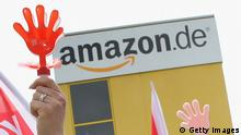 LEIPZIG, GERMANY - MAY 14: Amazon workers wearing bibs of the ver.di service industry labour union blow into whistles while striking outside the Amazon warehouse on May 14, 2013 in Leipzig, Germany. Approximately 5,000 Amazon workers at the Leipzig and Bad Hersfeld warehouses have gone on a 24-hour strike in an effort to press the company harder in their ongoing labour dispute over wages and work hours. (Photo by Sean Gallup/Getty Images)