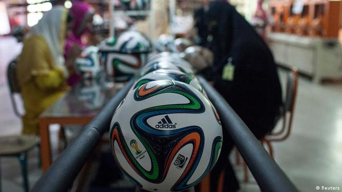 Employees work near official 2014 World Cup balls at the final stage of their quality check inside the soccer ball factory that produces official match balls for the World Cup in Brazil, in Sialkot, Punjab province May 16, 2014 (Photo: REUTERS/Sara Farid)
