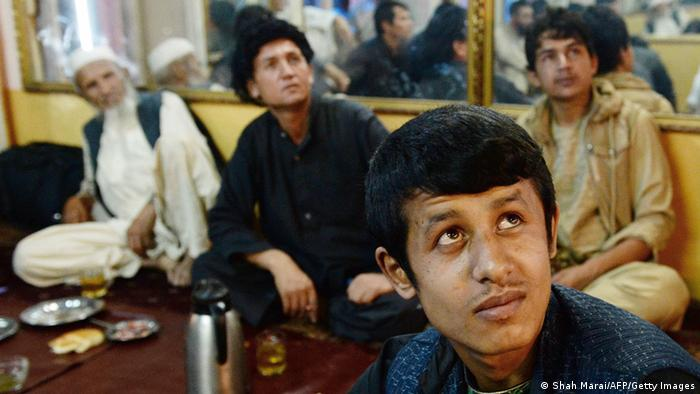 Afghans watching football on television