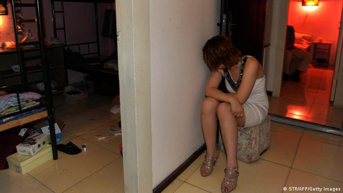 A masseuse detained on suspicion of prostitution in Beijing