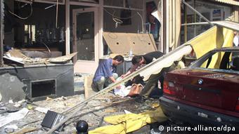 A destroyed shop (Foto: DPA)