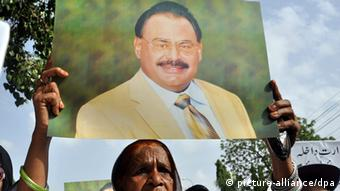 A supporter of Pakistani political party Mutahida Qaumi Movement (MQM) holds a portrait of party leader Altaf Hussain during a protest against government, in Karachi, Pakistan, 16 May 2014 (Photo: EPA/SHAHZAIB AKBER)