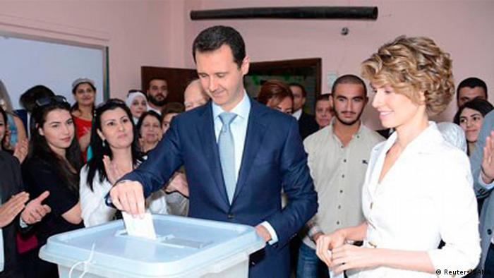 Asma Assad with her husband President Bashar al-Assad, casting a vote in the 2014 elections. He was reelected amid raging violence