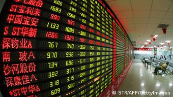 A stock ticker is displayed on a long board Photo: STR/AFP/GettyImages