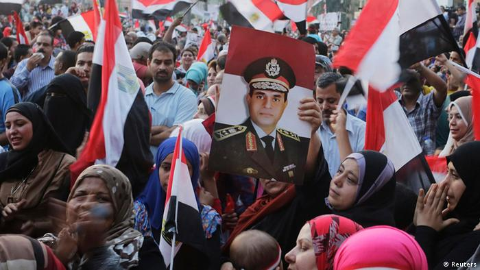 Supporters cheer after al-Sisi's victory was announced