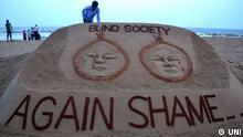 Protest nach Gruppenvergewaltigung und Ermordung zweier Mädchen in Indien Sandskulptur