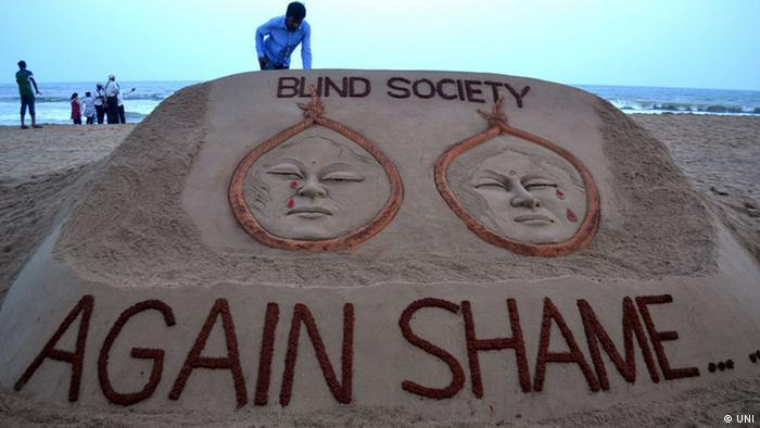 International sand artist Sudarsan Pattnaik created a sand sculpture on two sisters gang rape and murder issue of Badaun Uttar Pradesh with a message Blind Society Again shame at Puri beach of Odisha on Tuesday UNI PHOTO-113U Date/ Time: 20:53:23 PM Source: UNI City: PURI