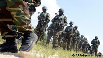 Nigerian amphibious army advance towards the enemy during a joint military exercise. Photo: PIUS UTOMI EKPEI/AFP/Getty Images