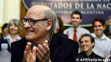 Argentine cartoonist Joaquin Lavado, known by his pen name Quino (C), creator of the famous cartoon strip Mafalda -translated to 15 languages- is applauded during a tribute ceremony for his 80th birthday held at the Argentine Congress in Buenos Aires on August 30, 2012. The cartoonist gained international recognition in 1969 with the European publication of Mafalda, la contestataria (Mafalda, the rebel) with a prologue by Italian writer Umberto Eco. AFP PHOTO / DANIEL GARCIA (Photo credit should read DANIEL GARCIA/AFP/GettyImages)