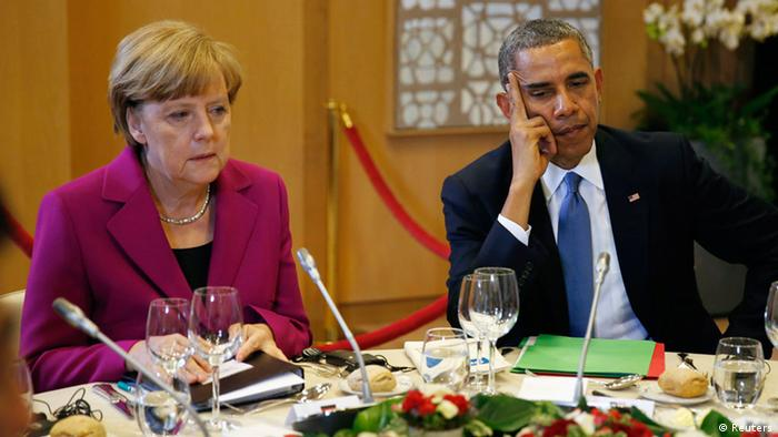 U.S. President Barack Obama and German Chancellor Angela Merkel listen during the G7 Summit working dinner in Brussels June 4, 2014. The world's leading industrialized nations meet without Russia for the first time in 17 years on Wednesday, leaving President Vladimir Putin out of the talks in retaliation for his seizure of Crimea and Russia's part in destabilizing eastern Ukraine. REUTERS/Kevin Lamarque