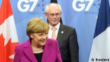 Germany's Chancellor Angela Merkel (L) is welcomed by European Council President Herman Van Rompuy at the European Council headquarters ahead of a G7 meeting in Brussels June 4, 2014. The world's leading industrialized nations meet without Russia for the first time in 17 years on Wednesday, leaving President Vladimir Putin out of the talks in retaliation for his seizure of Crimea and Russia's part in destabilizing eastern Ukraine. REUTERS/Laurent Dubrule (BELGIUM - Tags: POLITICS BUSINESS)