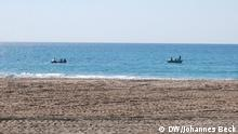 Fischerboote vor dem Strand von Tofo