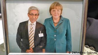 Metin Ilbay and Angela Merkel (Foto: DPA)