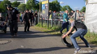 A Rock am Ring fan pushes a tire