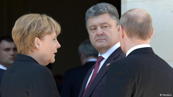 Ukrainian President-elect Petro Poroshenko (C), German Chancellor Angela Merkel (L) and Russian President Vladimir Putin (R) talk after a group photo during the 70th anniversary of the D-Day landings in Benouville June 6, 2014. Putin and Poroshenko called on Friday for a speedy halt to bloodshed and military actions in eastern Ukraine, Russian news agencies reported, citing the Kremlin's spokesman. REUTERS/Alexei Nikolskyi/RIA Novosti/Kremlin