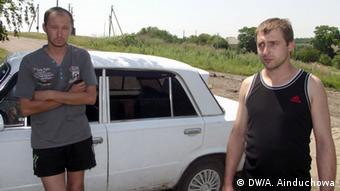 Two Ukrainian men, refugees