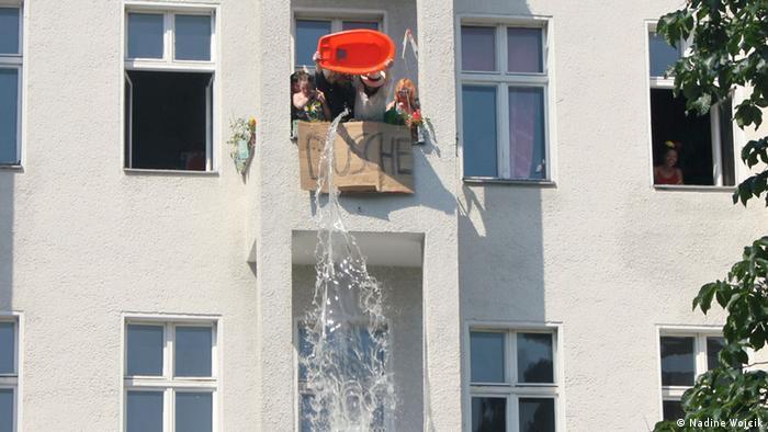Kreuzberg residents splash festival-goers with water