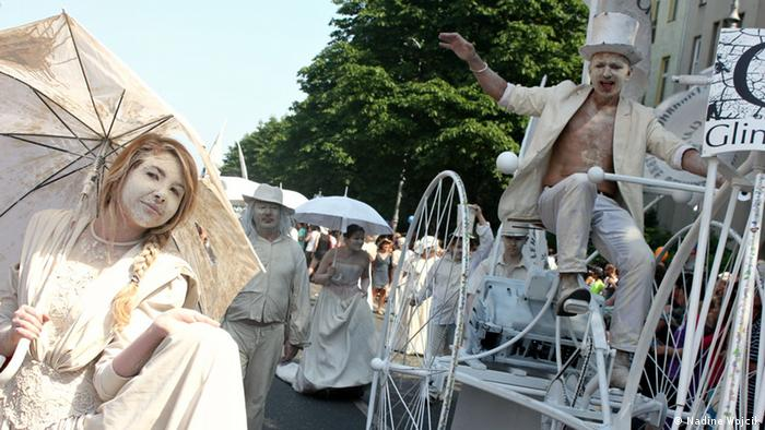 Parade participants dressed as clay people
