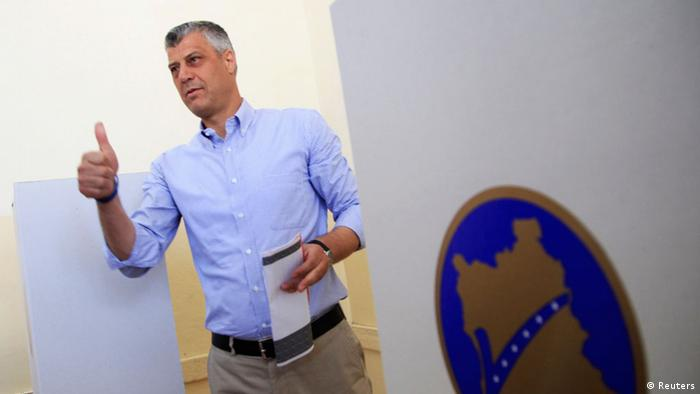 Hashim Thac - Kosovo's Prime Minister Hashim Thaci gestures at the polling station in the capital city Pristina June 8, 2014. Kosovo voted in an election on Sunday marked by voter frustration over poverty and corruption six years after seceding from Serbia, testing ex-guerrilla Thaci's bid for a third term as prime minister. REUTERS/Hazir Reka