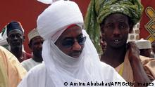 Nigeria's former Governor of the Central Bank of Nigeria and potential heir to the Kano emirate, Sanusi Lamido Sanusi (C), arrives at the royal palace in the northern Nigerian city of Kano, for the funeral of Ado Abdullahi Bayero, the late Emir of Kano, on June 6, 2014. Hundreds of thousands of people flocked the streets of Nigeria's second city on Friday to pay their final respects to the Emir of Kano, second in the hierarchy of Nigeria's Muslim monarchs and the ancient kingdom's longest-serving emir, ruling for 51 years until his death after a long battle with cancer. AFP PHOTO / AMINU ABUBAKAR (Photo credit should read AMINU ABUBAKAR/AFP/Getty Images)
