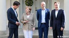 (L-R) Dutch Prime Minister Mark Rutte, German Chancellor Angela Merkel, Swedish Prime Minister Fredrik Reinfeldt and British Prime Minister David Cameron pose for photos at Reinfeldt's summer residence Harpsund, South of Stockholm June 9, 2014. REUTERS/Ander Wiklund/TT News Agency (SWEDEN - Tags: POLITICS) ATTENTION EDITORS - THIS IMAGE HAS BEEN SUPPLIED BY A THIRD PARTY. IT IS DISTRIBUTED, EXACTLY AS RECEIVED BY REUTERS, AS A SERVICE TO CLIENTS. SWEDEN OUT. NO COMMERCIAL OR EDITORIAL SALES IN SWEDEN